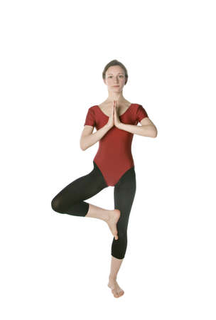 Woman in a red leotard exercising over white background Stock Photo - 8457086