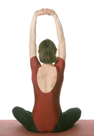 Woman exercising on a mat over white background photo