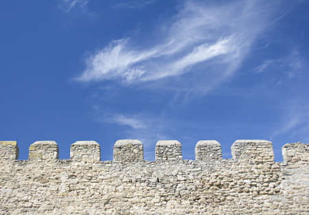 Merlons of an old fortress wall in a sunny day photo