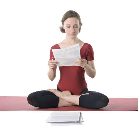 Young woman in sports clothes working with documents Stock Photo - 8931385