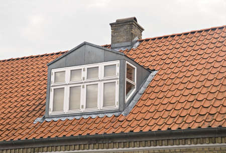 Roof with red tiling and dormer Stock Photo - 9040603