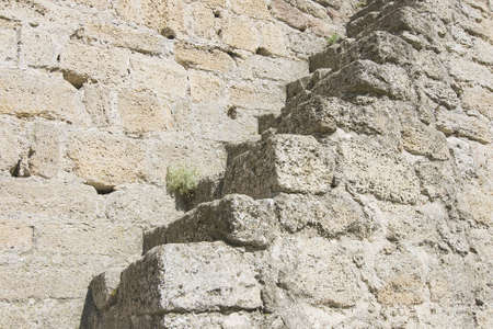 Stone ladder on an old medieval wall photo
