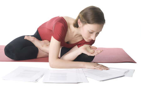 Young woman in sports clothes working with documents Stock Photo - 9185180