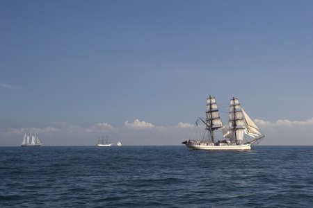 Ship with white sails in the calm sea Stock Photo - 9300413