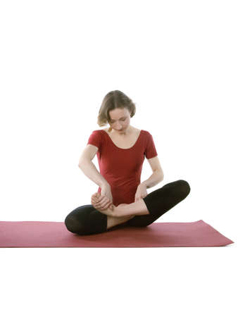 span: Woman trying to put herself in a lotus pose