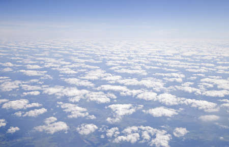 Blue and silver clouds background, view from airplane photo