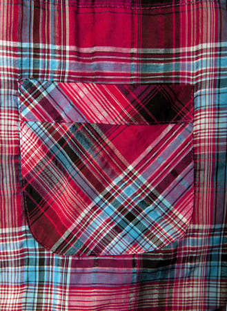 checked shirt: Pocket of a  red checked shirt, close-up Stock Photo