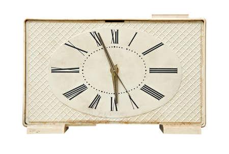 Old alarm clock isolated over white background photo