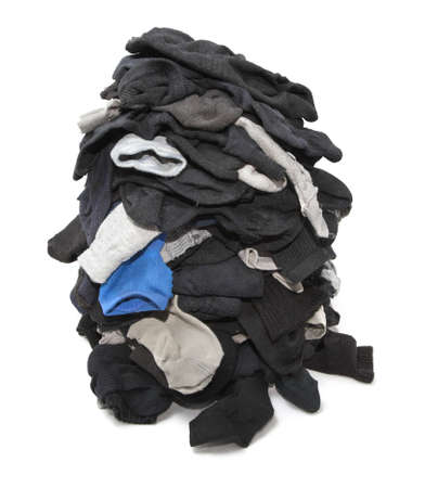 Heap of unsorted socks isolated over white