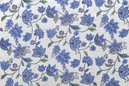 Close-up of fabric with blue flower pattern photo