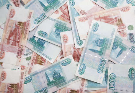roubles: Background of one and five thousand russian roubles bills