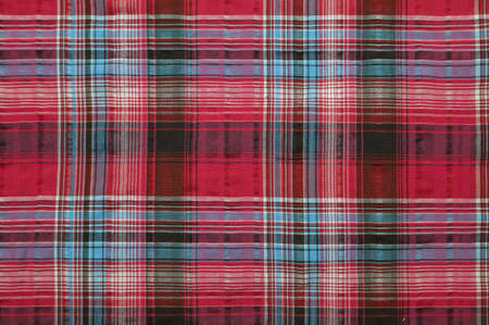Close-up of a piece of red checked fabric photo