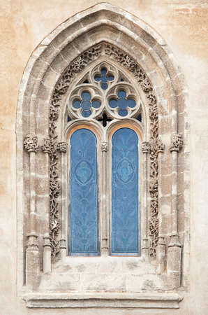 Ornamented window of a cathedral in gothic style Stock Photo