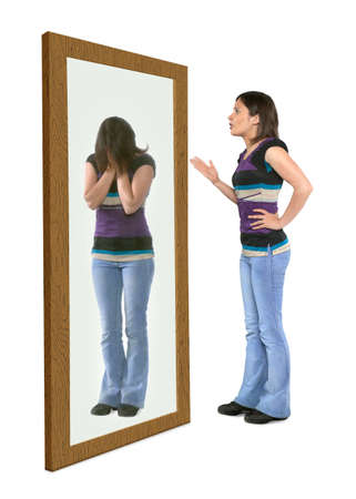 Woman scolding herself in a mirror