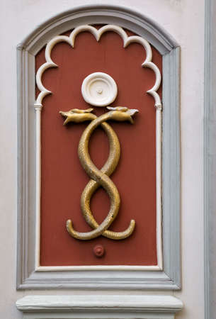 Wall decoration of two tangled snakes Archivio Fotografico