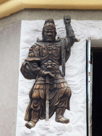 Warrior relief at the entrance of a Buddhist temple