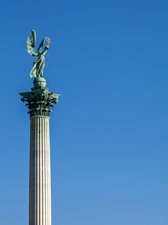 Statue of Archangel Gabriel on top of a column on Heroes square, Budapest
