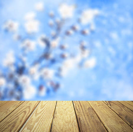 backdrop: Empty wood table over blurred flowers with bokeh background, product display template,deck,