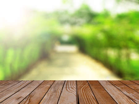 product display: Empty wood table over blurred green garden with bokeh background, product display template,deck,