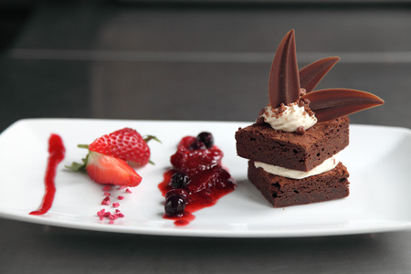 Chocolate brownie on a plate with garnish Stock Photo