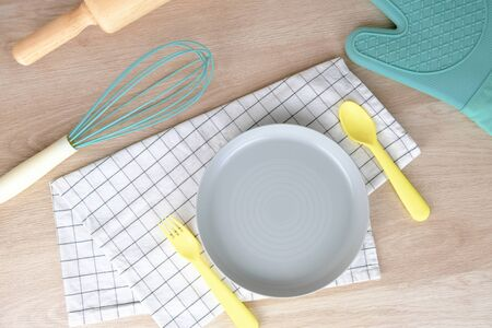 Blank dish or plate pastel color Bakery Party Breakfast at home. Cooking food with Rolling Pin and hand mixing on Wooden Background. Relax Hobby