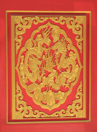 golden dragon on red wood in chinese temple  photo