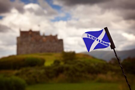 scottish flag: Scottish flag with an out of focus castle in the background.