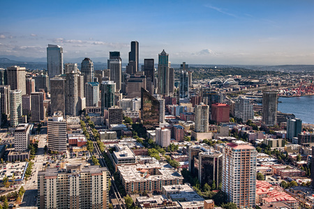 puget sound: SEATTLE, WA - SEPTEMBER 19, 2011: Aerial view of downtown Seattle, showing the edge of Puget Sound and Mount Rainier in the distance. Editorial
