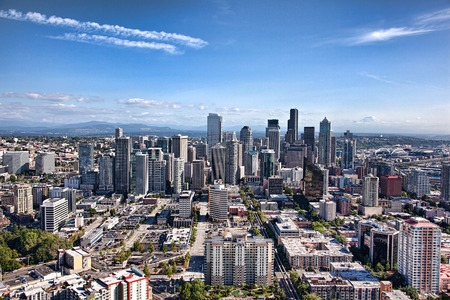 the emerald city: SEATTLE, WA - SEPTEMBER 19, 2011: Wide aerial cityscape of Seattle on a clear day with Mount Rainier in the distance.