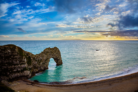 jurassic coast: Durdle Door on the Jurassic Coast of Dorset in the south of England at sunset.