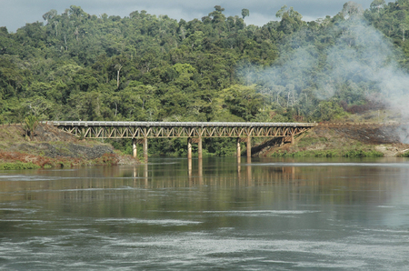 Railwaybridge over the water near the powerstation in Brokopondo, Surinam