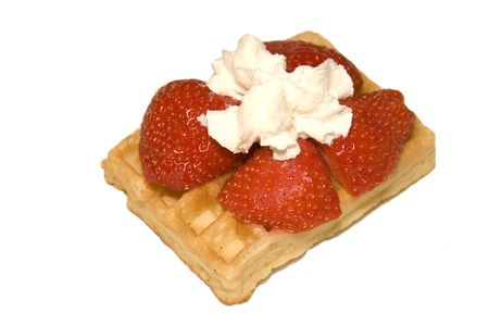Belgium waffle with strawberries and cream on it Stock Photo