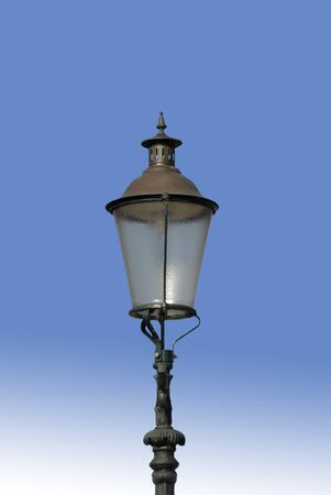 Oldfashioned Electric Lamppost against a blue sky