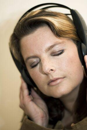 Beautiful girl listening to music with headphones