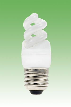 Energy saving lamp on a green background