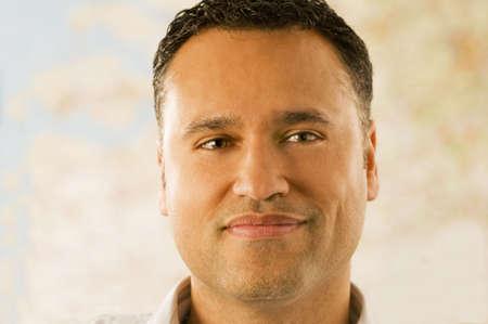 Portrait of a young businessman against a map