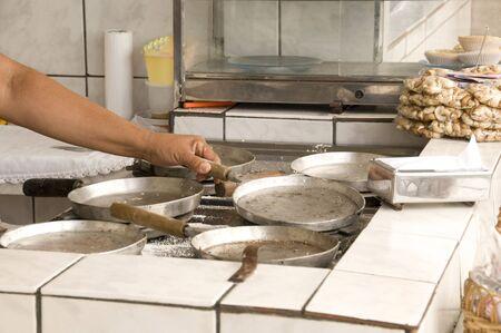 Woman preparing for cooking  in her poor brazilian kitchen