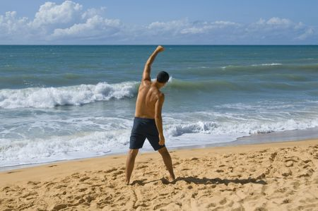 Man shouting for joy on the beach