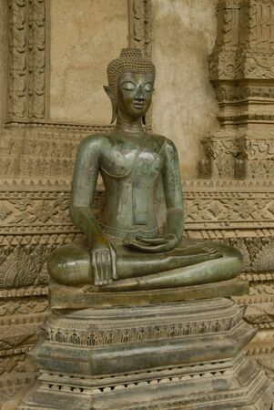 Sitting buddha in front of a temple in Laos, vientiane Stock Photo