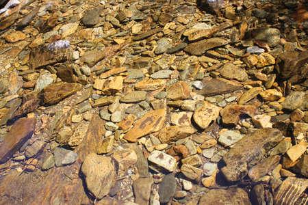 Stones under water photo
