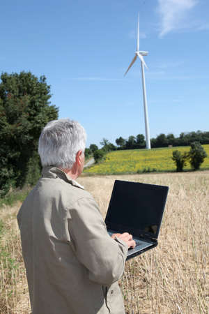 agronomist: Agronomist in wheat field with laptop computer