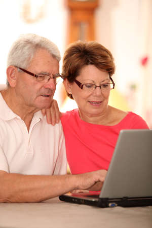 secured payment: Closeup of senior couple doing online shopping