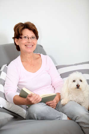 senior reading: Senior woman relaxing at home Stock Photo