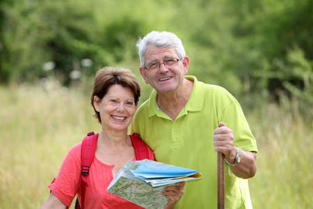 rambling: Closeup of senior couple rambling in countryside with map