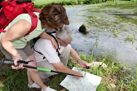 ramble: Senior couple looking at map on a bridge