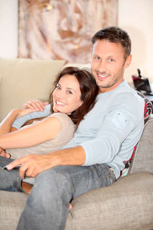 Couple relaxing at home in front of tv Stock Photo - 7544139