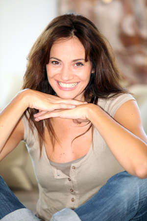 Closeup of beautiful woman relaxing at home Stock Photo - 7544113
