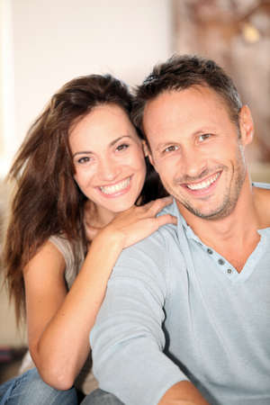 vertical: Closeup of happy couple at home Stock Photo