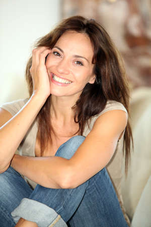 woman couch: Closeup of beautiful woman relaxing at home Stock Photo