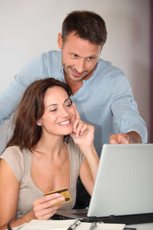 online transaction: Couple at home shopping on internet